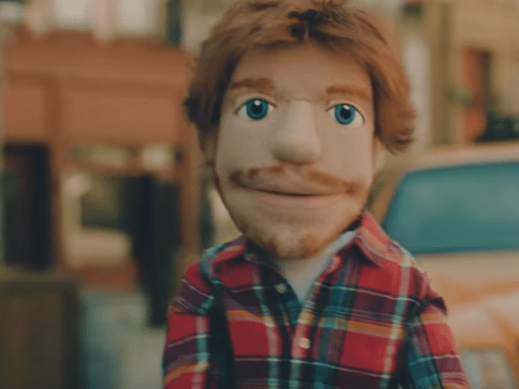Heartbroken 'Ed Sheeran' spies on ex-girlfriend with new boyfriend in Happier music video
